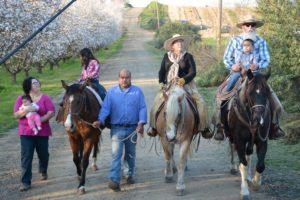 Burroughs Family on Horseback on farm